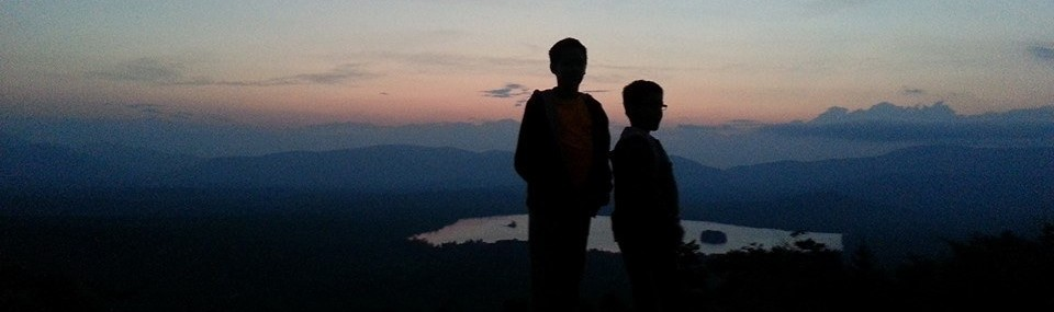 Boys silhouette at windmill lookout